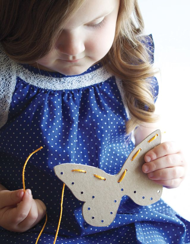 Sewing Cards - easy craft idea for little ones. Use recycled cereal boxes and shoelaces or yarn.