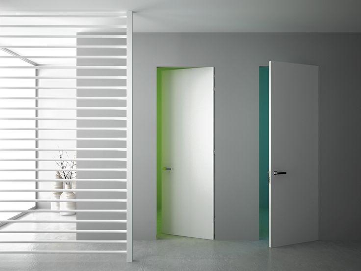 Porte raso muro 80x210 cm laccate bianche. I pannelli rimangono complanari alla parete sia nella versione a spingere che in quella a tirare. www.pannellofilomuro.it