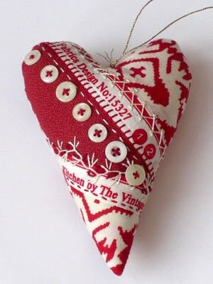 red pieced-fabric heart ornament with decorative embroidery stitches & buttons