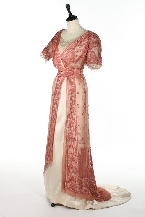 A G & E Spitzer of Vienna embroidered pink chiffon and ivory satin gown with day and evening bodices, circa 1910. -