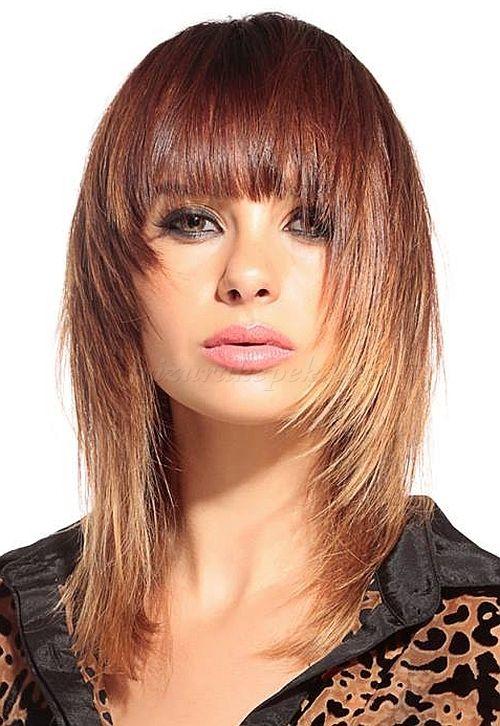női frizurák hosszú hajból - lépcsőzetesen nyírt hosszú haj