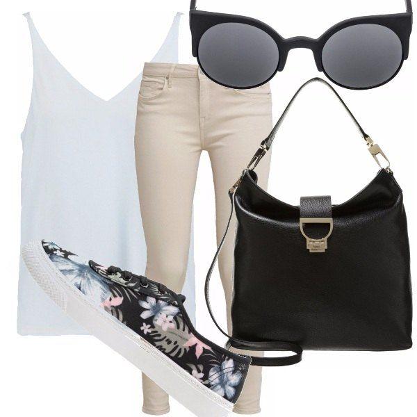 Outfit dai toni chiari e accessori neri per essere semplice ed elegante durante tutto il giorno. Un look davvero easy, pensato in particolare per scuola e università visto la borsa capiente e pratica.