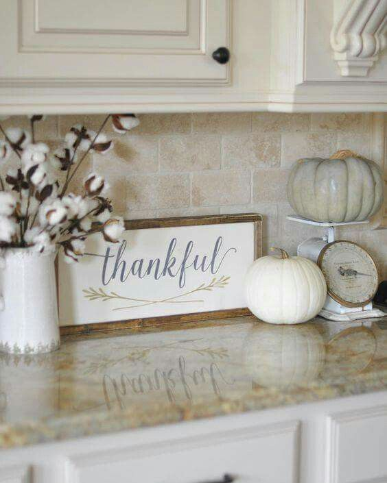 decorate with cotton stems and pumpkins on kitchen scales