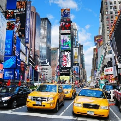 Times Square with traffic in Manhattan, New York City.