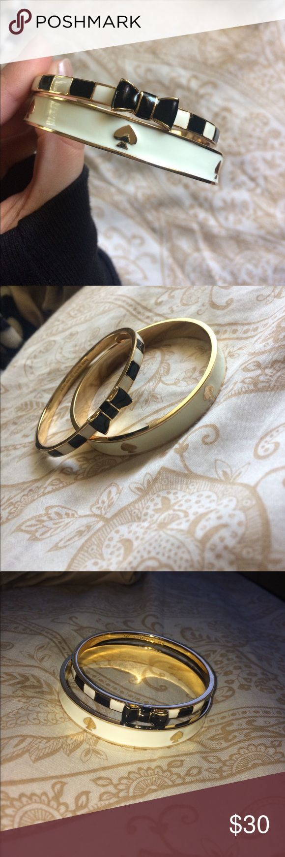 ♠️Kate spade bracelets♠️ Set of 2 Kate spade bracelets. One white with black spades and the other black and white with a bow. Both gold on the insides. Excellent condition! kate spade Jewelry Bracelets