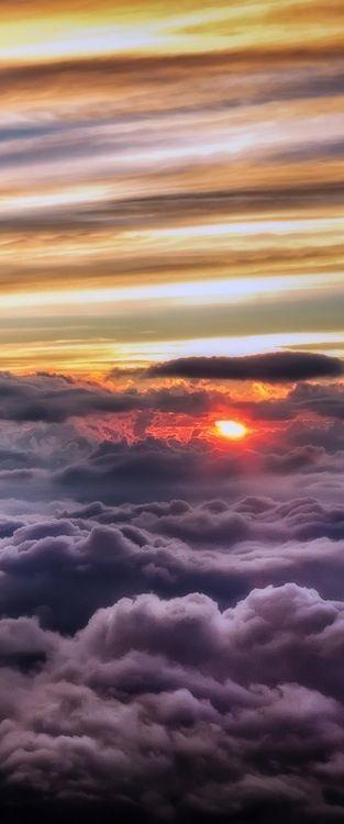 Sun peeping through storm clouds