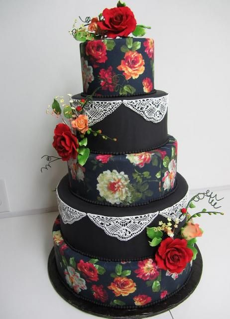 A black cake with sugar lace, sugar roses and other flowers and beautiful hand-painted roses. Gorgeous.