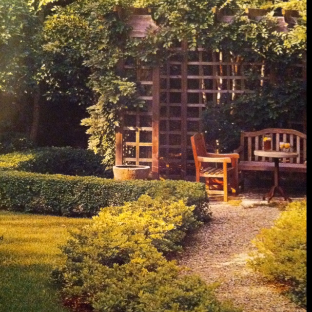 A pea gravel path leading to a shady pergola- perfect for a cool drink on a hot day.