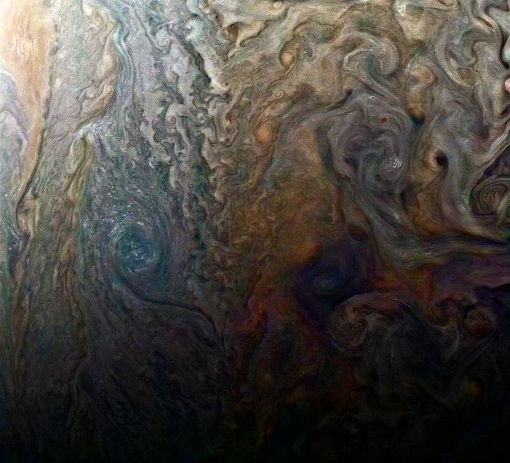 NASA's Juno spacecraft has consistently been coming through with the best close-up images of Jupiter we've ever seen. But a newly released, enhanced-color image of a large dark spot might be the most ethereal of all—its swirling, colorful clouds make it seem like a Jovian Van Gogh.