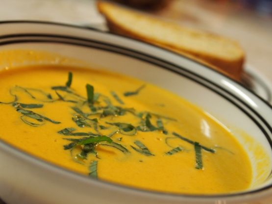 A rich tomato bisque - which makes a nice change from salsa and pasta sauce with an overabundant tomato garden.  I used the recommended mint, and thought basil might be a more appropriate herb.  This recipe could really work with any color ripe tomato - but the yellow/orange tomatoes make a really pretty soup. I used 2 cups of stock because I like thicker soups - use 3 if you prefer it thinner. From Fine Cooking.
