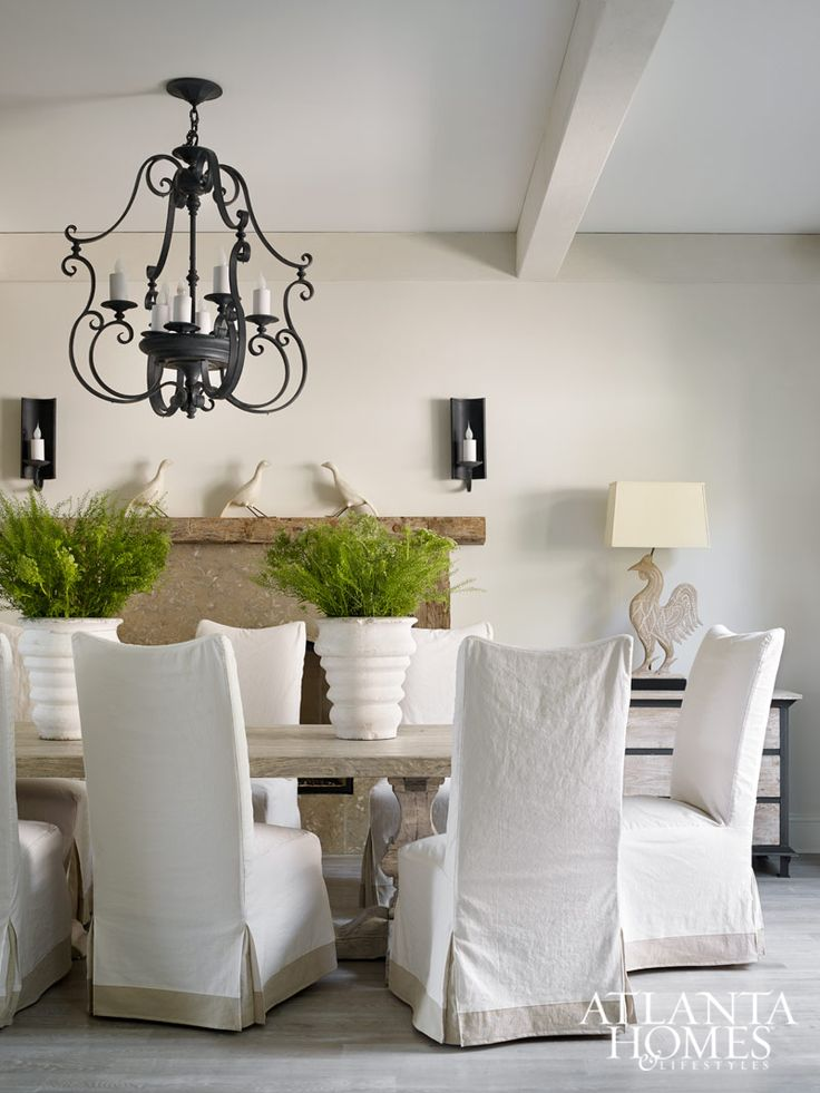 Neutral Dining Room And Pedestal Table With Slipcovered Chairs