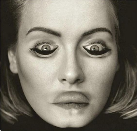 Flipping this picture of Adele upside down results in something seriously scary.
