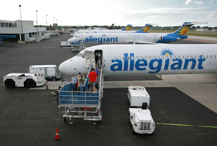 Tampa Bay passengers board an Allegiant flight to Lexington, Ky., on Tuesday. The airline flies nonstop and charges for extras.