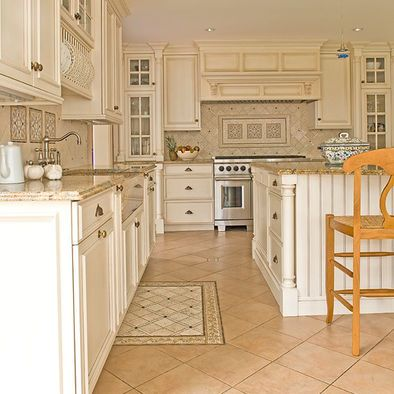 Ceramic Tile Kitchen Floor - love the different tile in front of the sink. Like the half-turn of the tile.