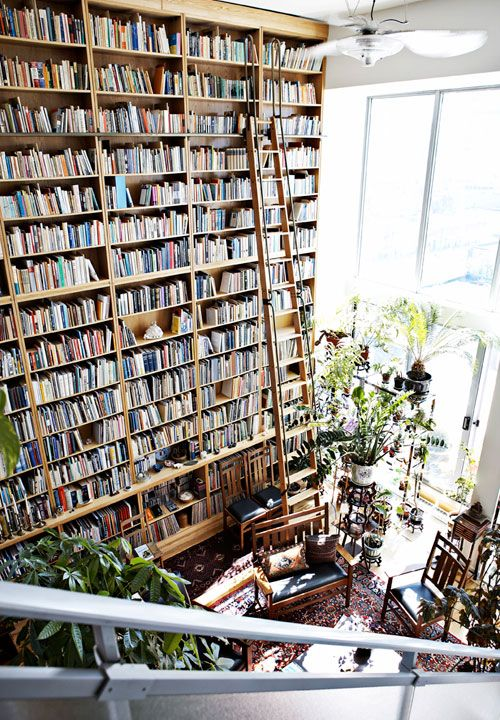 Dennis' floor-to-ceiling custom library shelves from Issue 3 (November 2010) of Covet Garden Magazine. Photographed by Tracy Shumate.