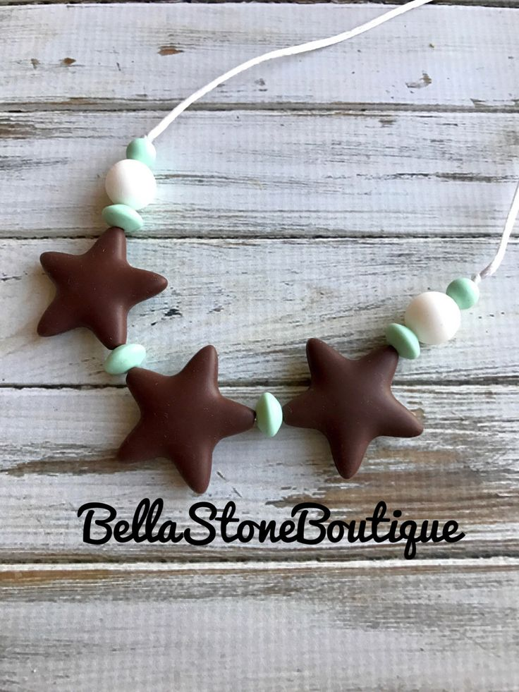 Mommy wearing star teething bead necklace.Chocolate brown, mint,white teething necklace.Silicone bead.Teething bead necklace. Baby teething by BellaStoneBoutique on Etsy https://www.etsy.com/listing/502085593/mommy-wearing-star-teething-bead