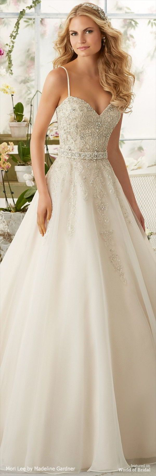 Crystal Beaded Embroidery Cascades onto the Organza Ball Gown with Shoestring Straps