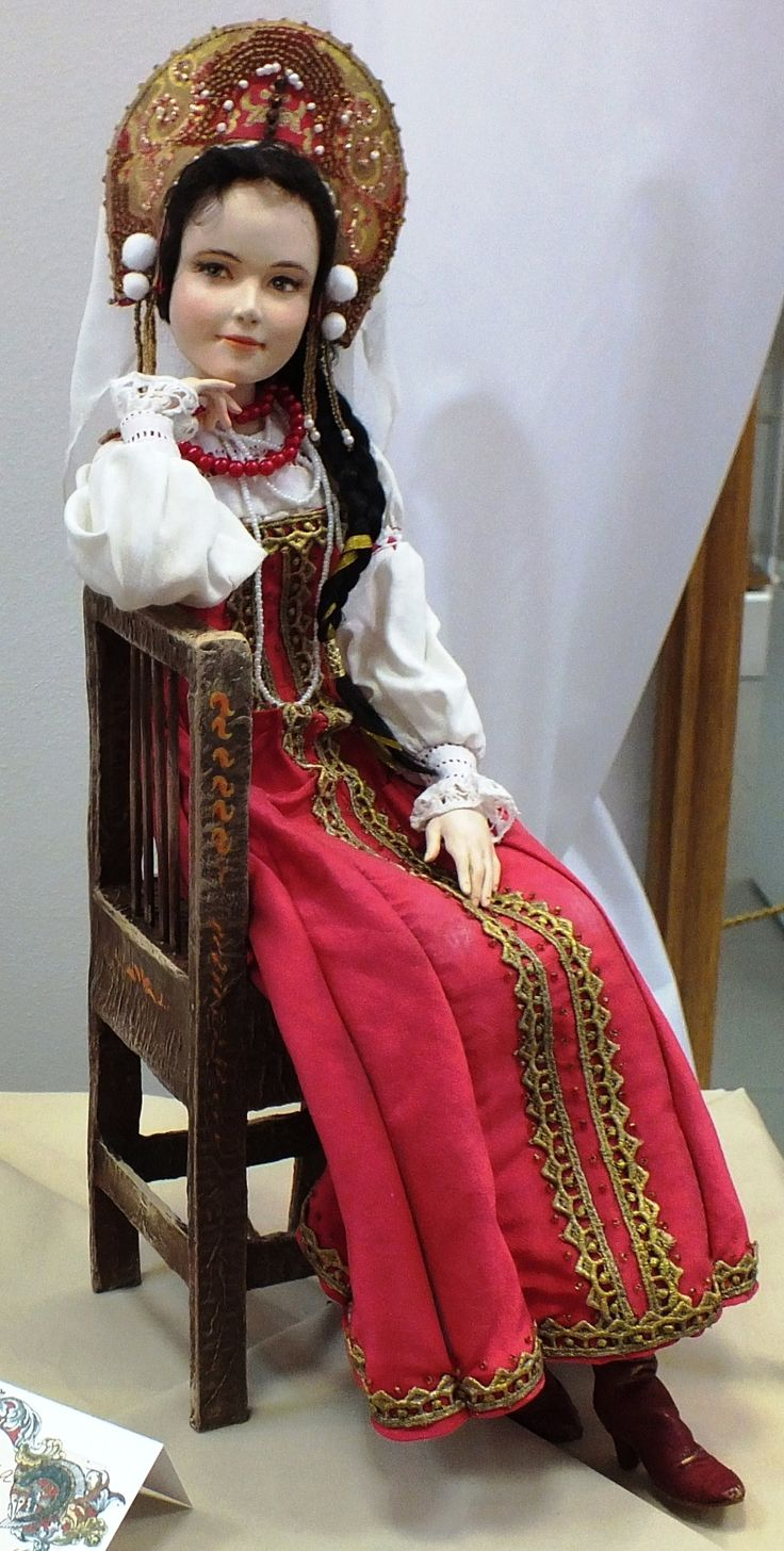 A Russian doll in a traditional costume and in a kokoshnik headdress.