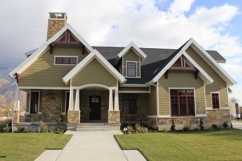 Craftsman. The traditional Craftsman home builds from the Prairie Style with addition of exposed rafters, decorative brackets under the eaves and stone porch supports and chimney. Updates: This new construction played up the Craftsman style home with more complex roof lines and color combination.