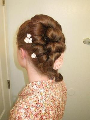 18th Century Style Tutorial.  Not Edwardian... but it has some useful tips.  Those rolls in back are perfect for 1910's hair.