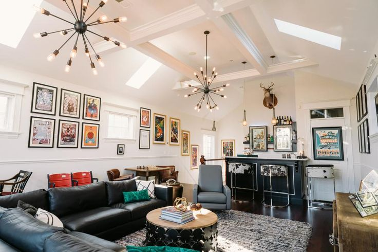 In this Chicago game room, a mix of vintage furniture and eclectic accessories gives the space a vibrant personality –– the life of any party. Multiple seating areas and a custom bar anchor the space with functionality and style.