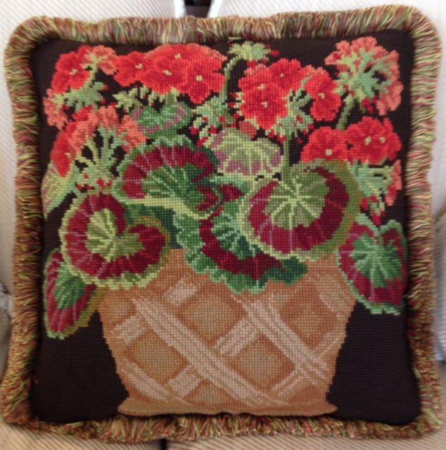Elizabeth Bradley needlepoint Geranium in Pot with brown background