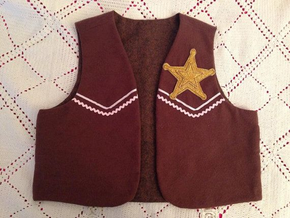 Sheriff Callie vest - Brown lining.  $27... MAYBE she would do two for $50, one with purple thread too?