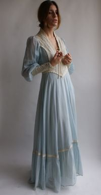Mom made me a Gunne Sax dress similar to this pattern.  I still have it put away in my keep sakes