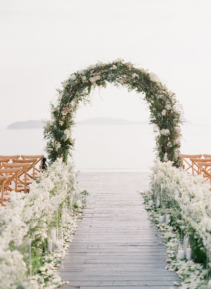Floral wedding arch: Flowers: IAMFLOWER - http://www.iamflower.co Photography: Vasia Photography - vasia-weddings.com   Read More on SMP: http://www.stylemepretty.com/2017/02/28/this-just-might-be-the-prettiest-ceremony-spot-youll-ever-lay-eyes-on/