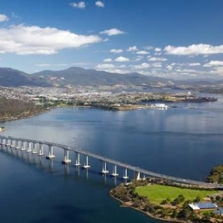 Tasman Bridge, Hobart, Tasmania. On Sunday 5 January 1975, the bridge was struck by the bulk carrier Lake Illawarra, carrying 10,000 tonnes of zinc ore concentrate. It caused two pylons and three sections of concrete decking to fall from the bridge and sink the ship. Twelve people were killed, including seven crew and the five occupants of four cars which fell after driving off the bridge. We used a temporary Bailey bridge to cross the Derwent River in March 1977. It reopened in October…