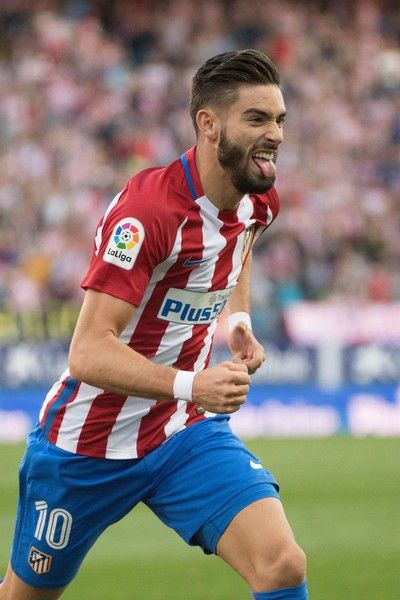 Atletico Madrid's Belgian midfielder Yannick Ferreira Carrasco celebrates a goal during the Spanish league football match between Club Atletico de Madrid and Malaga CF at the Vicente Calderon stadium in Madrid on October 29, 2016. / AFP / CURTO DE LA TORRE
