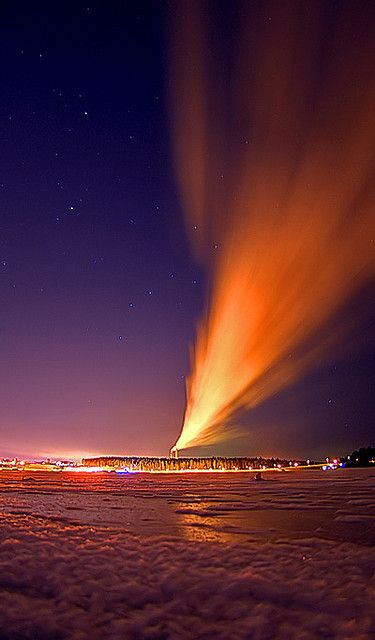 Feather by Antti-Jussi Liikala, via FlickrUrsa Major in the middle sky. Steam from a power plant reflects the city lights.