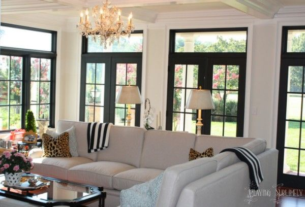 Black French Doors and inside transom windows but white trim.