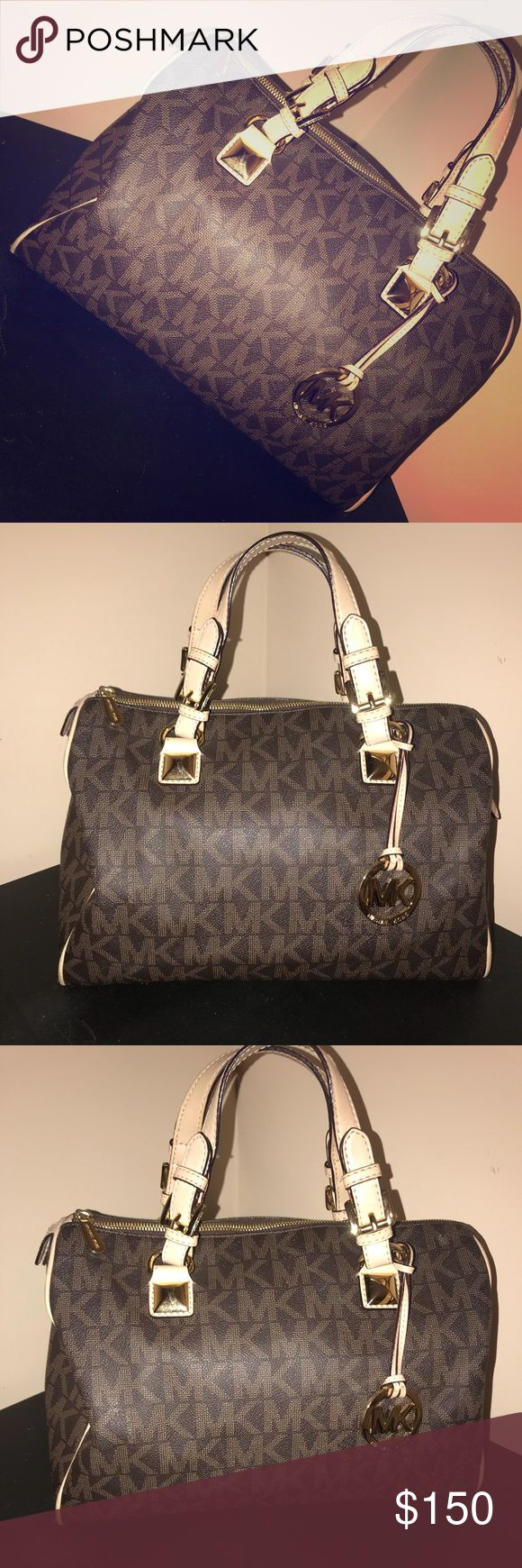 Authentic Michael Kors Bag Michael Kors Large Grayson bag. Outside is in excellent condition. Bottom of the inside lining has some staining (see pics) KORS Michael Kors Bags Satchels
