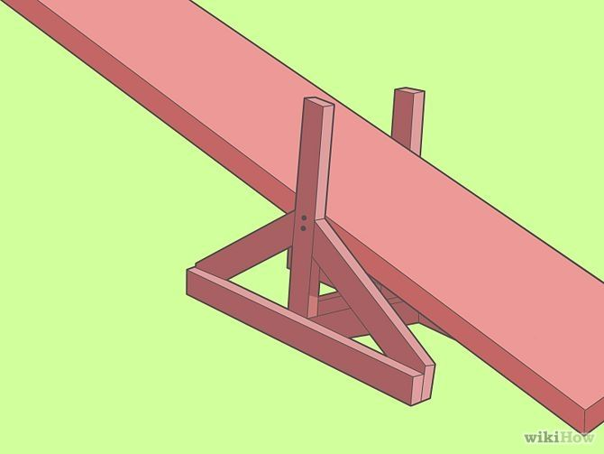 Learn how to build an adjustable dog agility seesaw with non-slip footing.