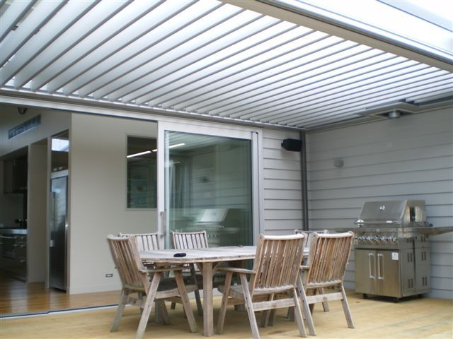 Outdoor entertaining area with opening louvretec roof for weather and sun control