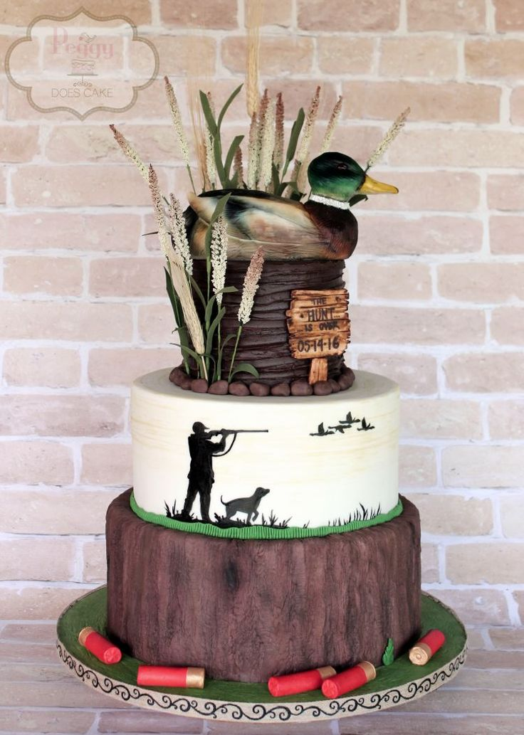 Mallard duck groom's cake (shells made from fondant; duck made from rice krispie treats and modeling chocolate) #duckcake #groomscake #mallardcake #hunting cake