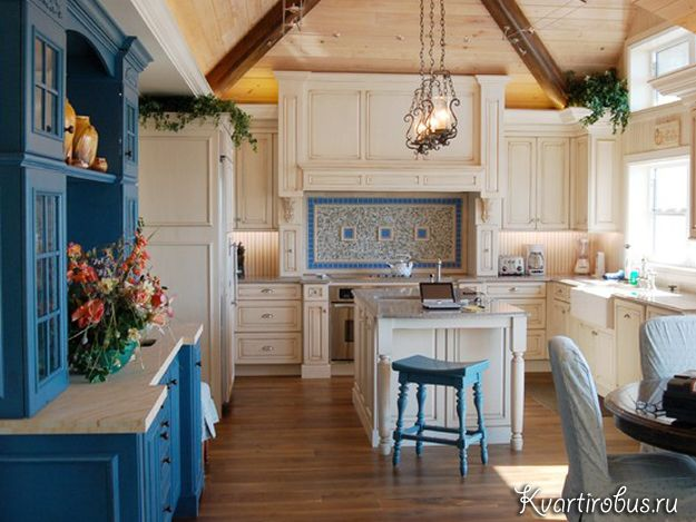 The kitchen in the Mediterranean style in beige and blue colors in the image filled with a warm family atmosphere and comfort.