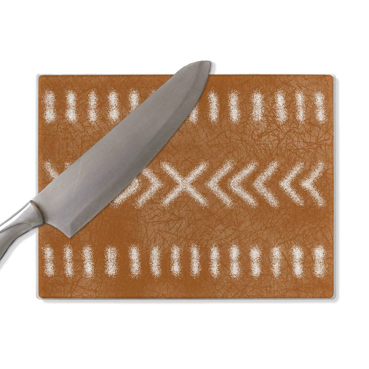Lime green glass chopping board, tribal pattern
