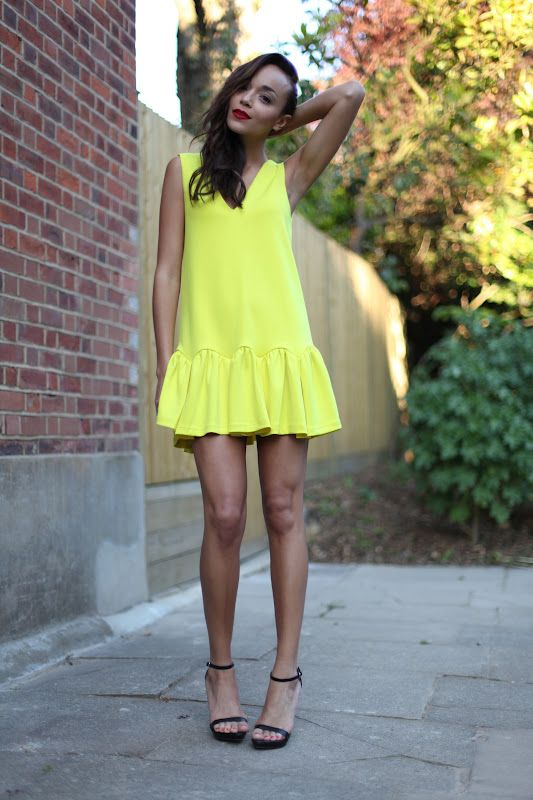 Love Ashley Madekwe's bright yellow frock.