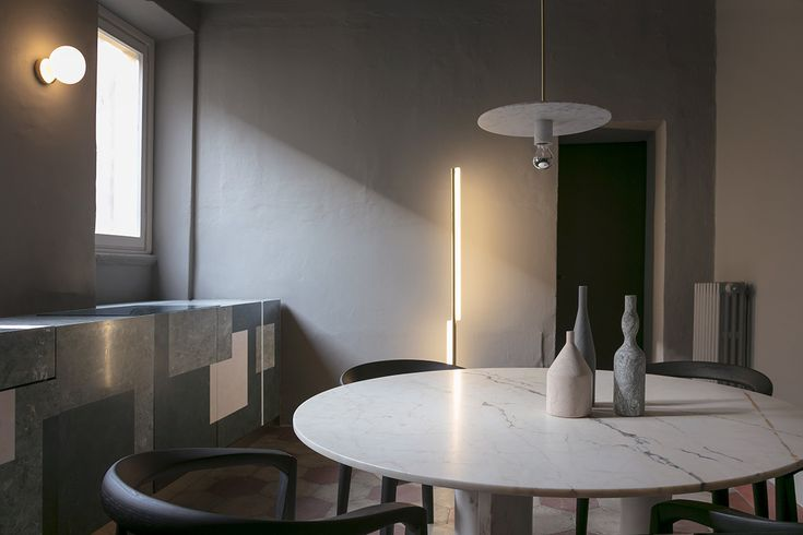 """Kitchen: Project, kitchen design, table accessories_Omaggio a Morandi, by Elisa Ossino for Salvatori; Table_""""Love Me, Love Me Not"""" by Michael Anastassiades for Salvatori; Chairs_Miss by Afra and Tobia Scarpa, Molteni; Lamp_One Well-Known Sequence Aluminium by Michael Anastassiades, wall paint by File Under Pop."""