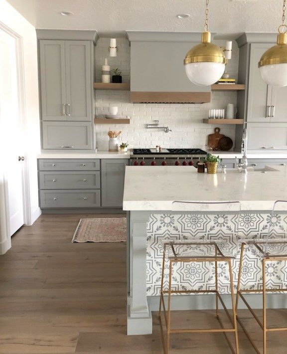 New project kitchen! This fresh gray kitchen pairs rustic warmth with modern styling details. Think patterned tile, brick backsplash, and painted cabinetry.