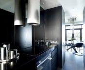 Greg Natale designed property with a palette of dark greys and deep blacks #kitchen #minimalist #design