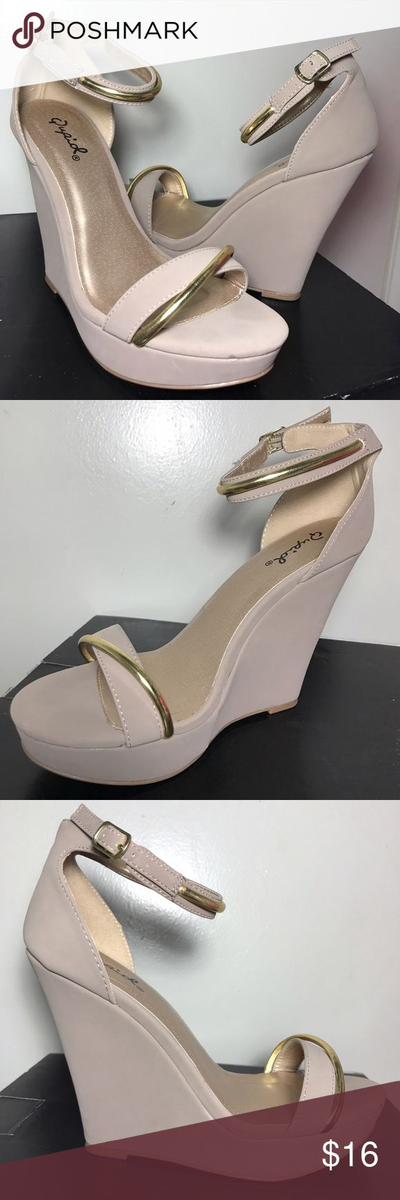 Ankle strap wedge sandal Single band topped with metallic strip accent across open toe with adjustable ankle strap also adorned with metallic strip accent. Back zipper for easy on/off set on a wrapped platform wedge *gently used in good condition without shoebox* last photo shows soles *fits true to size* Qupid Shoes Wedges