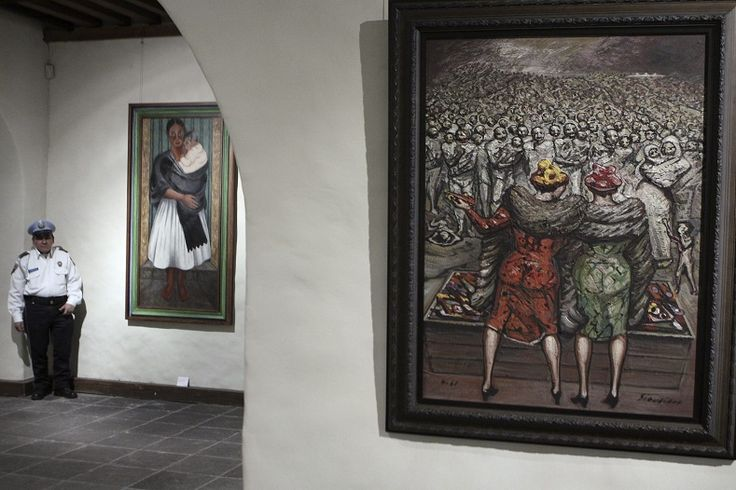 """The work, """"Delivering Toys,"""" (R), by David Alfaro Siqueiros, is seen during the press opening of the exhibition """"Faces and Traditions of Mexico,"""" which opens to the public this Thursday at the Museo del Carmen in Mexico City, 2010."""
