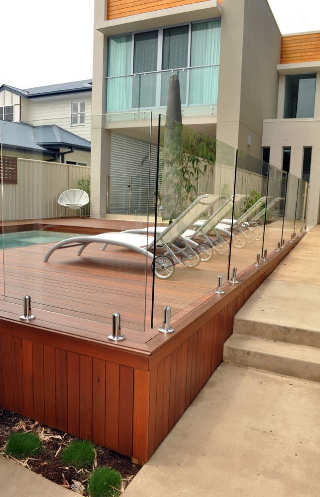 Fully Frameless Glass Pool Fencing On Deck At Bundall Phone 1800 335 464 For A Free Site Visit And Quote Poollandsca Timber Deck Glass Fence Wooden Pool Deck