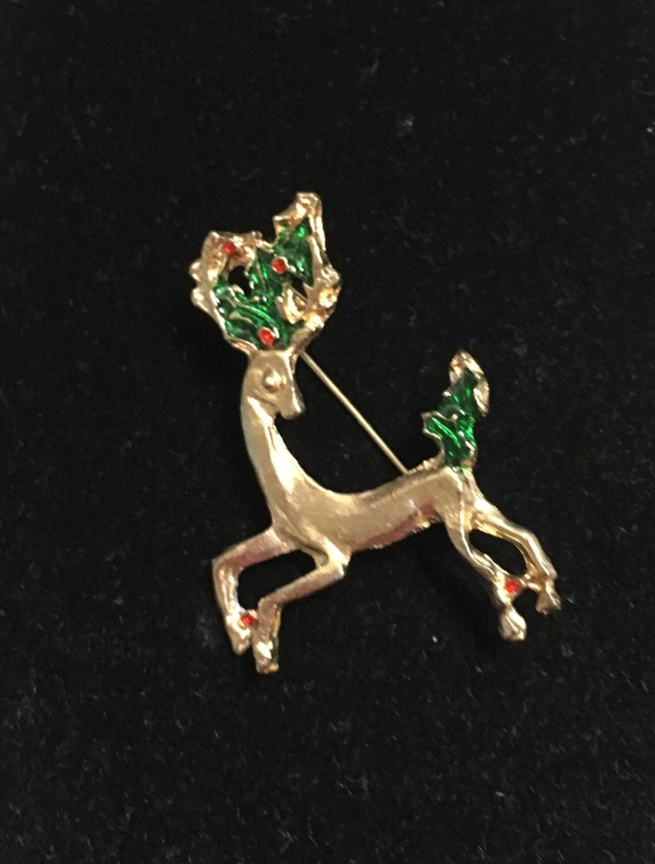 Reindeer Brooch, Vintage Christmas Motif, Gold Tone, Clearance Sale, Item No. X12 by ESTATENOW on Etsy https://www.etsy.com/listing/169813971/reindeer-brooch-vintage-christmas-motif