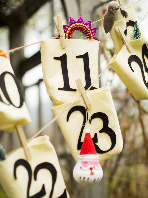 How To Make No-Sew Advent Calendar Bags: We made our Advent calendar for a stock-the-Christmas-tree bridal shower. Each guest was instructed to bring an ornament to gift the happy couple with, then stuff them in these no-sew bags for a festive gift-opening experience. The bride was thrilled to go home with a tree's worth of ornaments, plus an Advent calendar that can be used year after year. From DIYnetwork.com