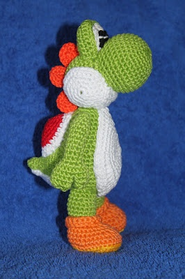 Knitting Pattern For Yoshi Toy : Cute little dragon Yoshi, from the Mario Bros. family. The first big...