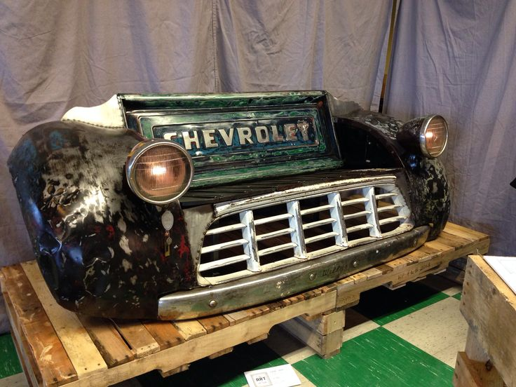 This was cool...won first place at junk bonanza in mn...it's an old Chevy tailgate as the back, the grill where your legs are and the fenders as the arm rests!